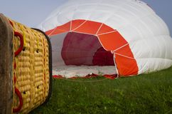 Preparing for a hot air ballon flight. Inflating and preparing the hot air balloon for flight on a foggy morning royalty free stock photo