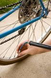 Inflating the tire of a bicycle royalty free stock photography