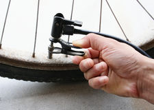Inflating the tire of a bicycle Royalty Free Stock Images