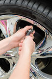 Inflating Tires. Inflate tires and check pressure before traveling Stock Photos
