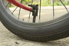 Inflating used bicycle wheel Stock Images