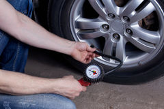 Inflating the wheels. Inflating the automobile wheels via a pump Royalty Free Stock Photos