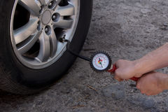 Inflating the wheels. Inflating the automobile wheels via a pump Stock Photography