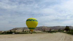 Yellow Hot Air Balloon Waiting For Take-Off in Cappadocia. Inflating a yellow hot air balloon in Cappadocia, Central Anatolia, Turkey Stock Photography