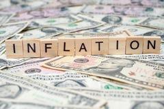 INFLATION im Holzklotz Stockbild