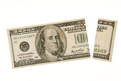 Inflation Returns. A one hundred dollar bill with a section cut off.  Money doesn't go as far as it used to Stock Photo