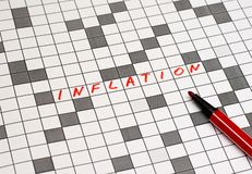 Inflation. Text in crossword. Red letters royalty free stock image