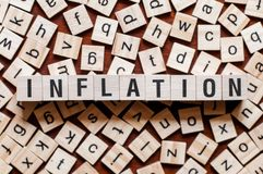 Inflation word concept. On cubes stock photography