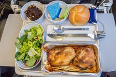 Inflight dinner meal in economy class. royalty free stock image