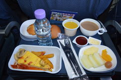 Inflight meal. Inflight vegetarian meal on a flight in an airplane stock photo