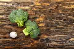 Inflorescence of raw broccoli on a wooden table, horizontal phot. O Stock Photos