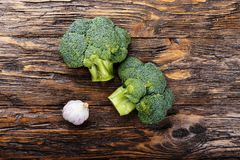 Inflorescence of raw broccoli on a wooden table, horizontal phot. O Royalty Free Stock Photo