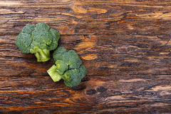 Inflorescence of raw broccoli on a wooden table, horizontal phot. Inflorescence of raw broccoli on a wooden table, With space for text, horizontal shot Stock Image