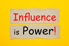 Influence Is Power. Written on old paper on yellow background. Business concept royalty free stock images