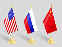 Influential states. Three flags stand influential countries in the world Stock Photos