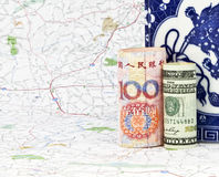 An influential team. Two currencies, yuan and dollar, placed together reflect the strong global influence of both economies and countries, the USA and China, in Royalty Free Stock Photo