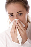 Influenza. Stock photo fo a young woman holding tissue stock images