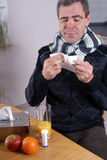 Influenza. Man with influenza and an handkerchief Stock Photo