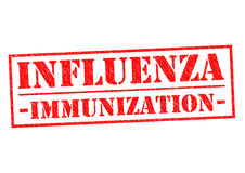 INFLUENZA IMMUNIZATION. Red Rubber Stamp over a white background Stock Images