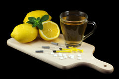 Influenza medical treatment. Influenza treatment with vitamins, tea and vaccines Royalty Free Stock Images