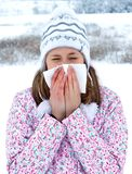 Influenza During Winter. Winter sickness concept - woman blowing her nose Stock Photos