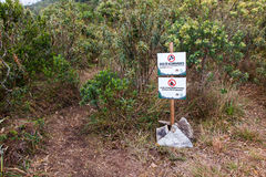 Info board indicating camping area in Serra Fina traverse in Mantiqueira Range. MINAS GERAIS, BRAZIL - JUL 01, 2017 - Info board indicating camping area in Serra Stock Images