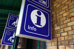 Info icon. The information desk icon is displayed in a train station Stock Photos