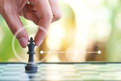 Infographics of Businessman holding a King Chess is placed on a chessboard.using as background business concept and Strategy conce. Pt with copy space for your Stock Image