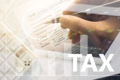 Infographics of Businessmen hold a pen to fill out an annual tax. Bill with a calculator to calculate the tax rate. as background business concept and finance Royalty Free Stock Image