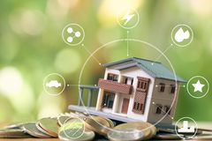 Infographics of A model house model is placed on a pile of coins.using as background business concept and real estate concept with. Copy space for your text or Stock Photos