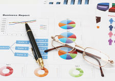Infographics pen and glasses. Image of infographics for business report with pen and glasses Stock Images