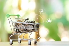 Infographics of Saving money concept of collecting coins Thai money in a Shopping Cart on nature background.  as background busi. Ness concept and Saving concept Stock Image