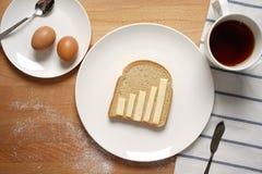 Infographics sur la table de petit déjeuner Image libre de droits