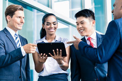 Informal business people with table computer discussing Royalty Free Stock Photos