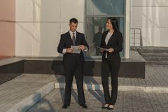 Business people while working near office building stock images