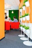 Informal meeting in corporate lobby Stock Photos
