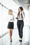 Informal meeting of two business women in modern office. royalty free stock images