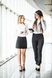 Informal meeting of two business women in modern office. Royalty Free Stock Image