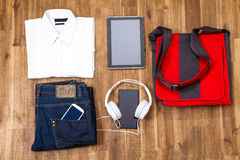 Informal outfit and electronics Stock Image
