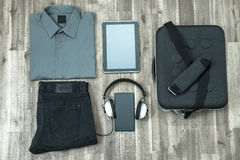Informal outfit and electronics Royalty Free Stock Photo