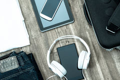 Informal outfit and electronics Stock Images