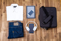 Informal outfit and electronics Royalty Free Stock Image
