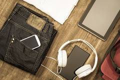 Informal outfit and electronics Royalty Free Stock Photos
