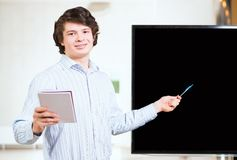 Informally dressed businessman shows blank screen Stock Image