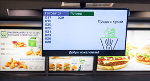 Information and advertising monitor in McDonald's restaurant. Royalty Free Stock Photography