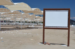 Information board on the beach. Sea Royalty Free Stock Images