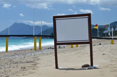 Information board on the beach. Sea Stock Images