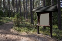 Information board in the forest royalty free stock photo