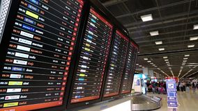 Information board inside arrival hall in international airport in Bangkok, Thailand stock footage