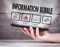 Information Bubble. Tablet computer in the hand. Old wooden background Royalty Free Stock Photography